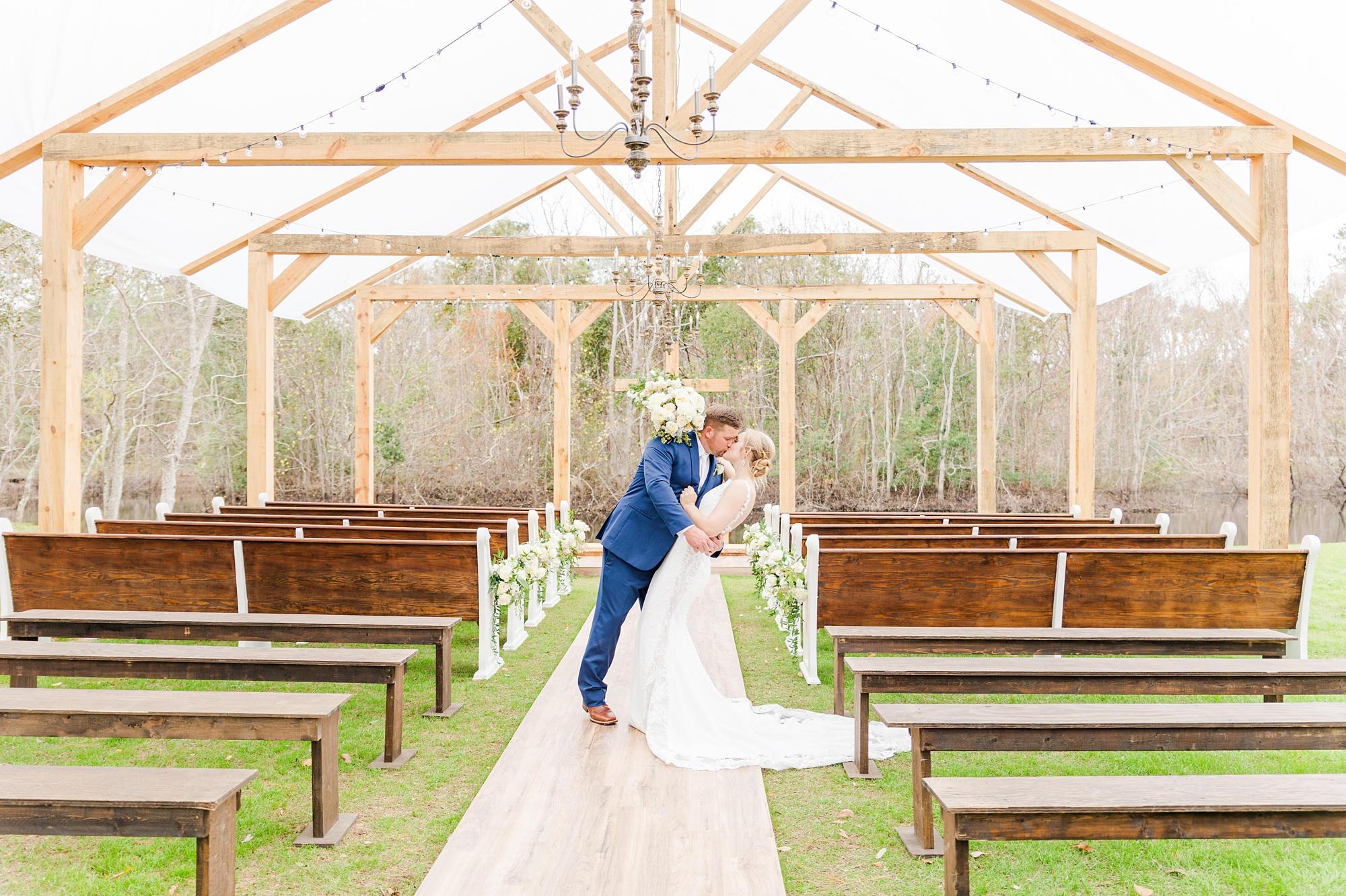 groom kisses bride during first look in Magnolia Springs AL