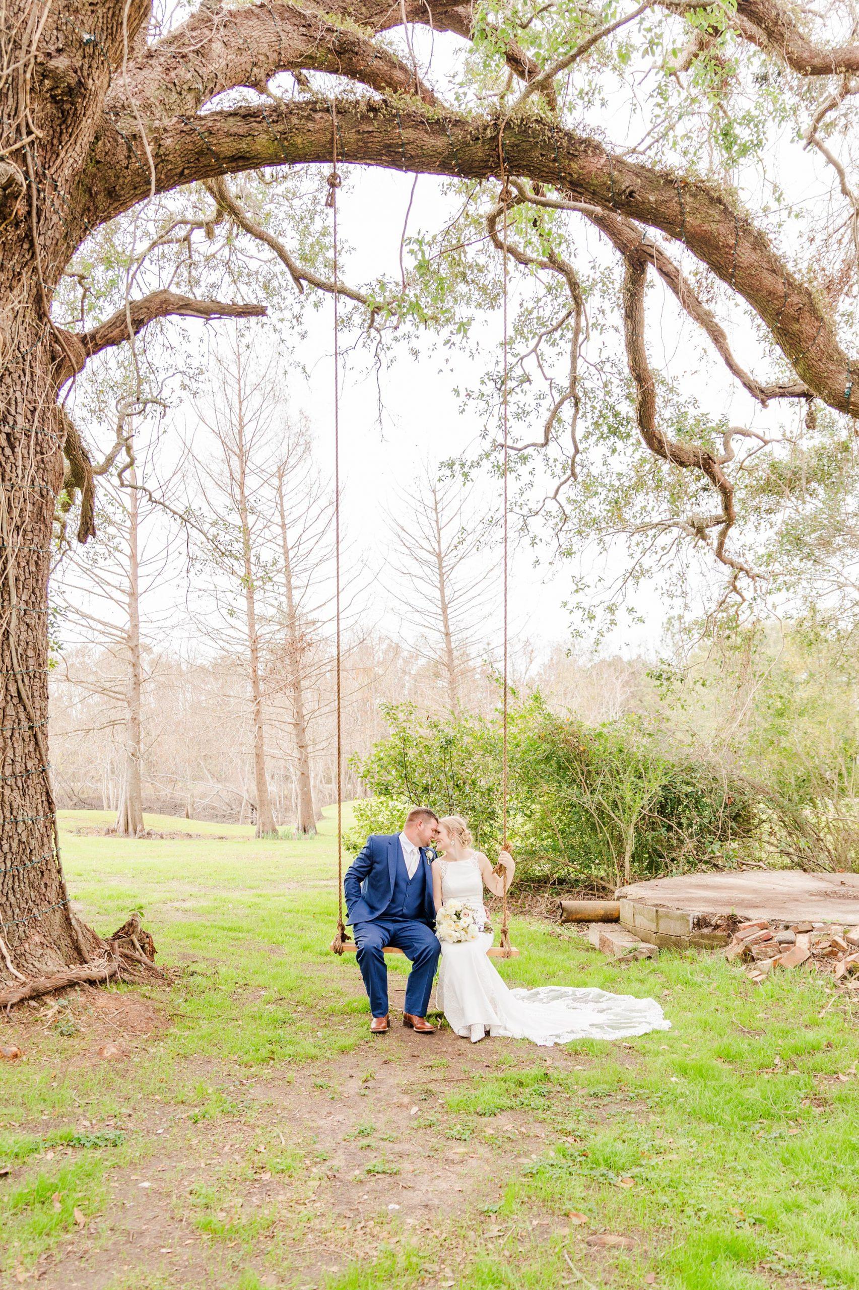 newlyweds swing on wooden swing