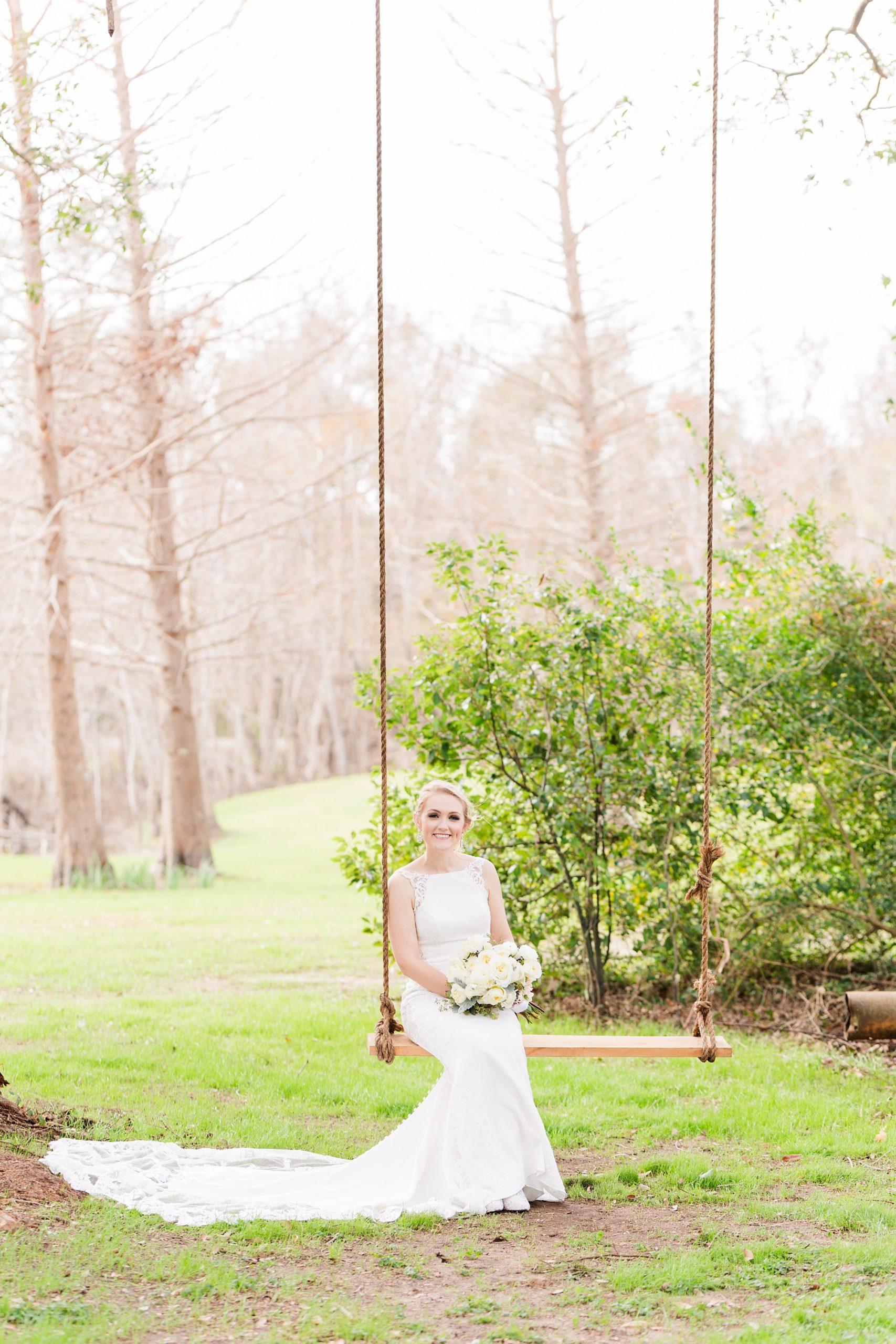 bride swings on wooden swing