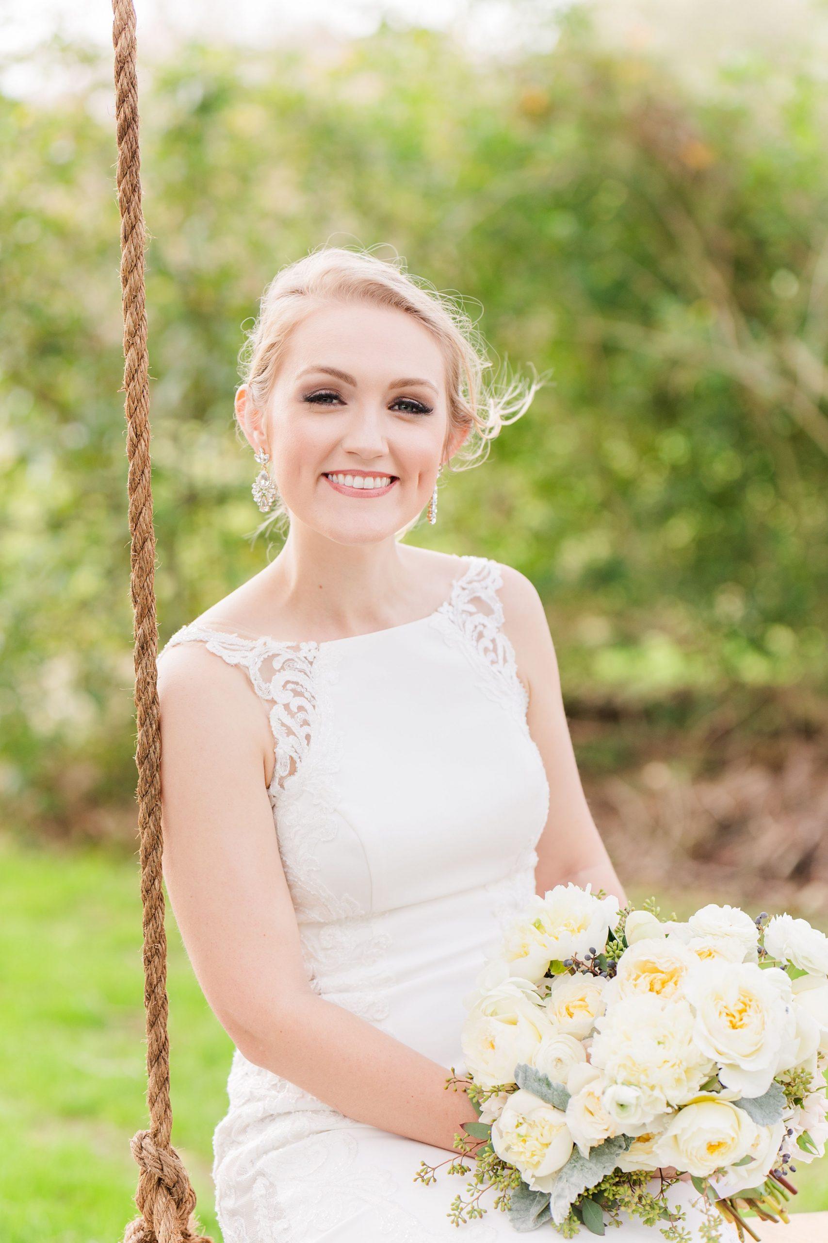 bride leans on rope during wedding portraits in Fairhope AL