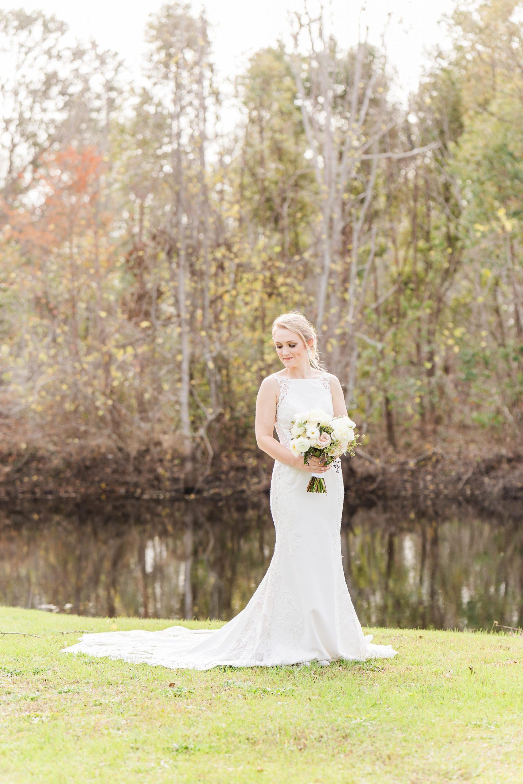 elegant bridal portrait by lake in Magnolia Springs AL