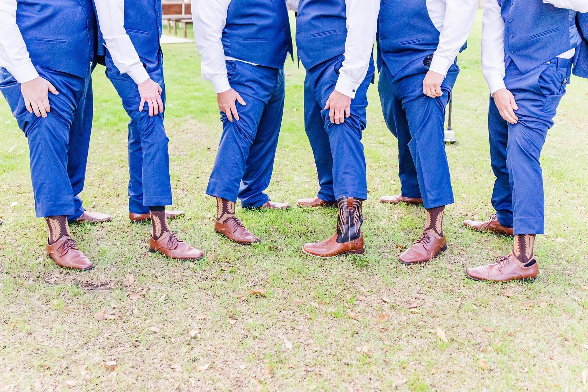 groom and groomsmen show off custom boots