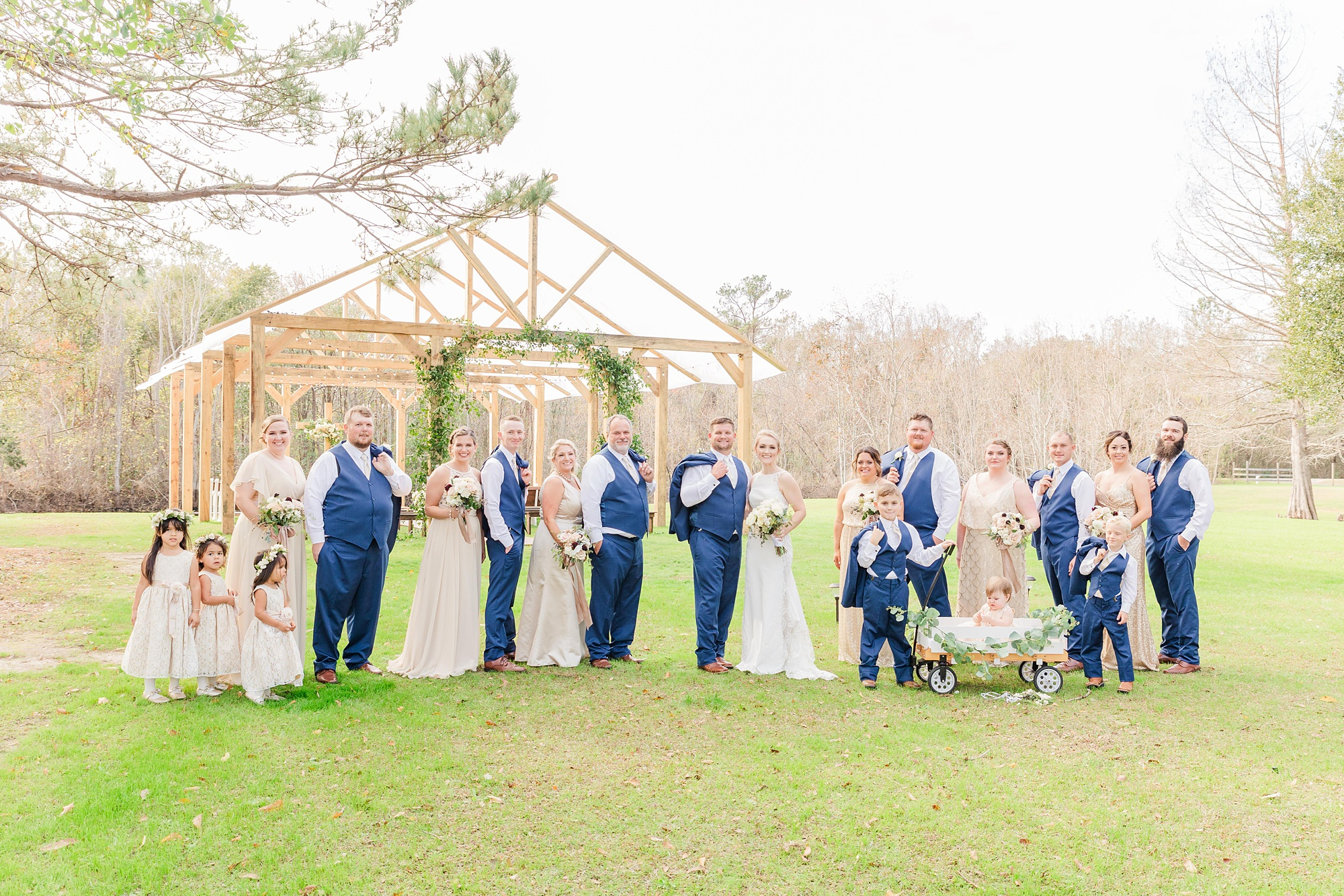 bride and groom pose with bridal party