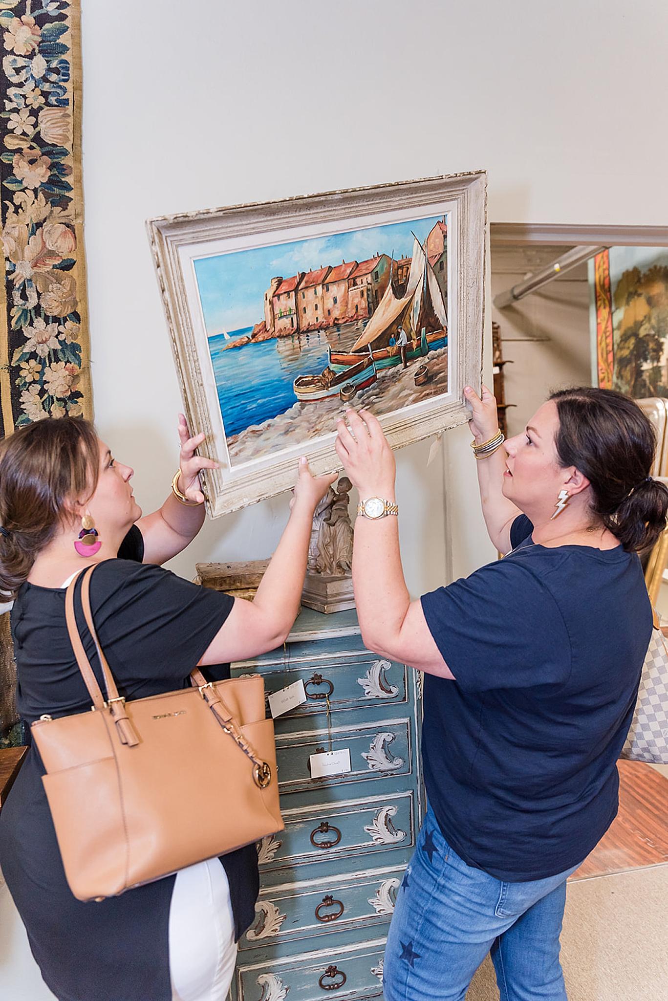 women look at painting during Fairhope AL branding portraits