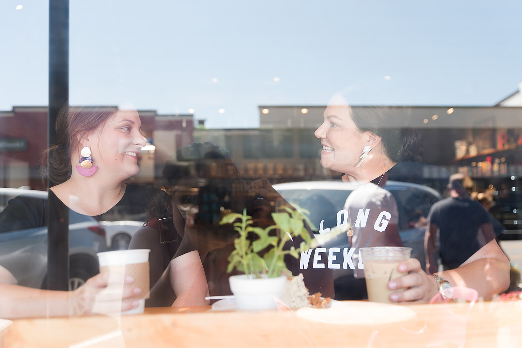 business owners chat in coffee shop during Fairhope AL branding portraits