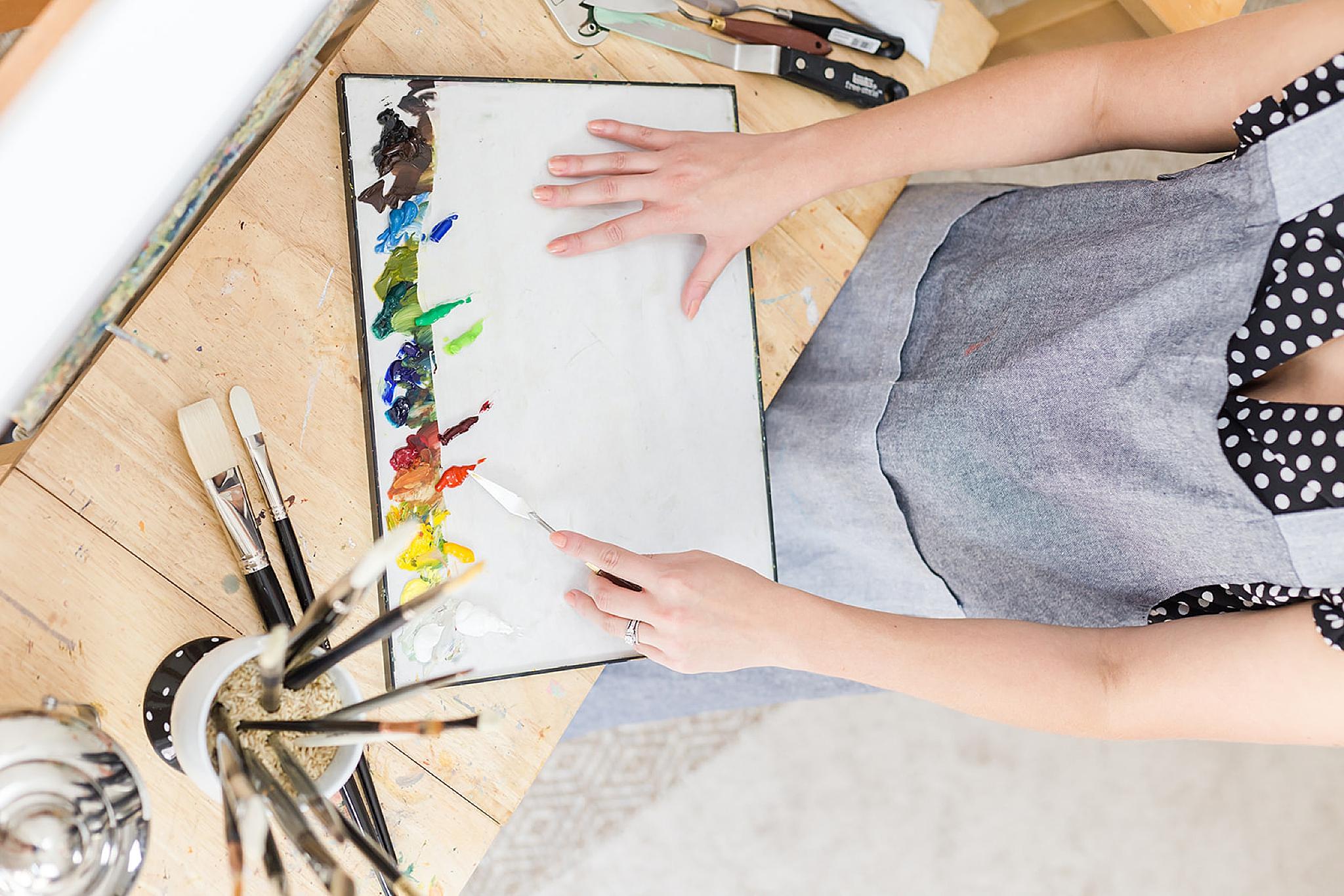 artist creates painting during Mobile AL branding portraits
