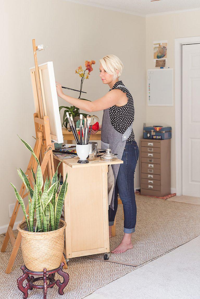 artist paints during Mobile AL branding portraits