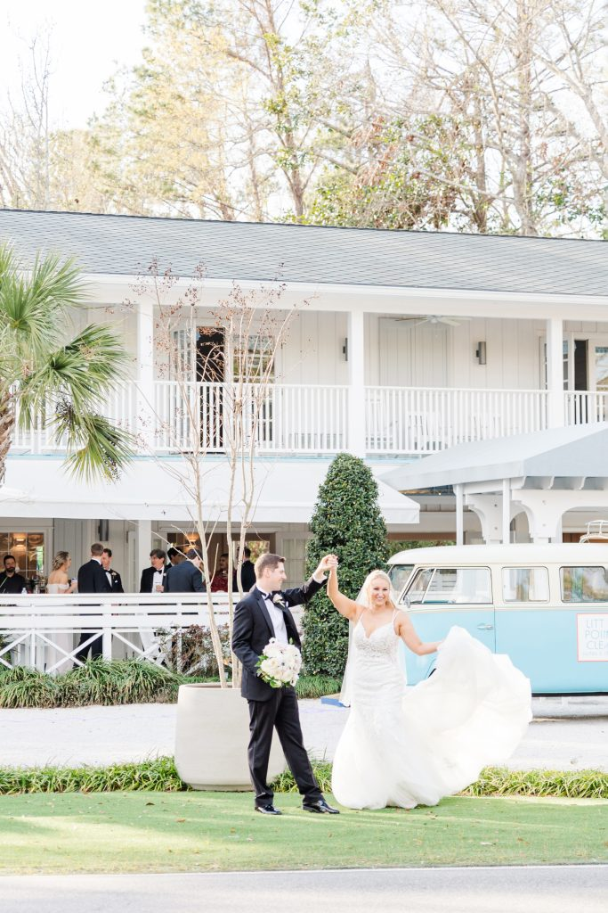 Bride and Groom dancing in front of their wedding venue Little Point Clear in Fairhope, Alabama