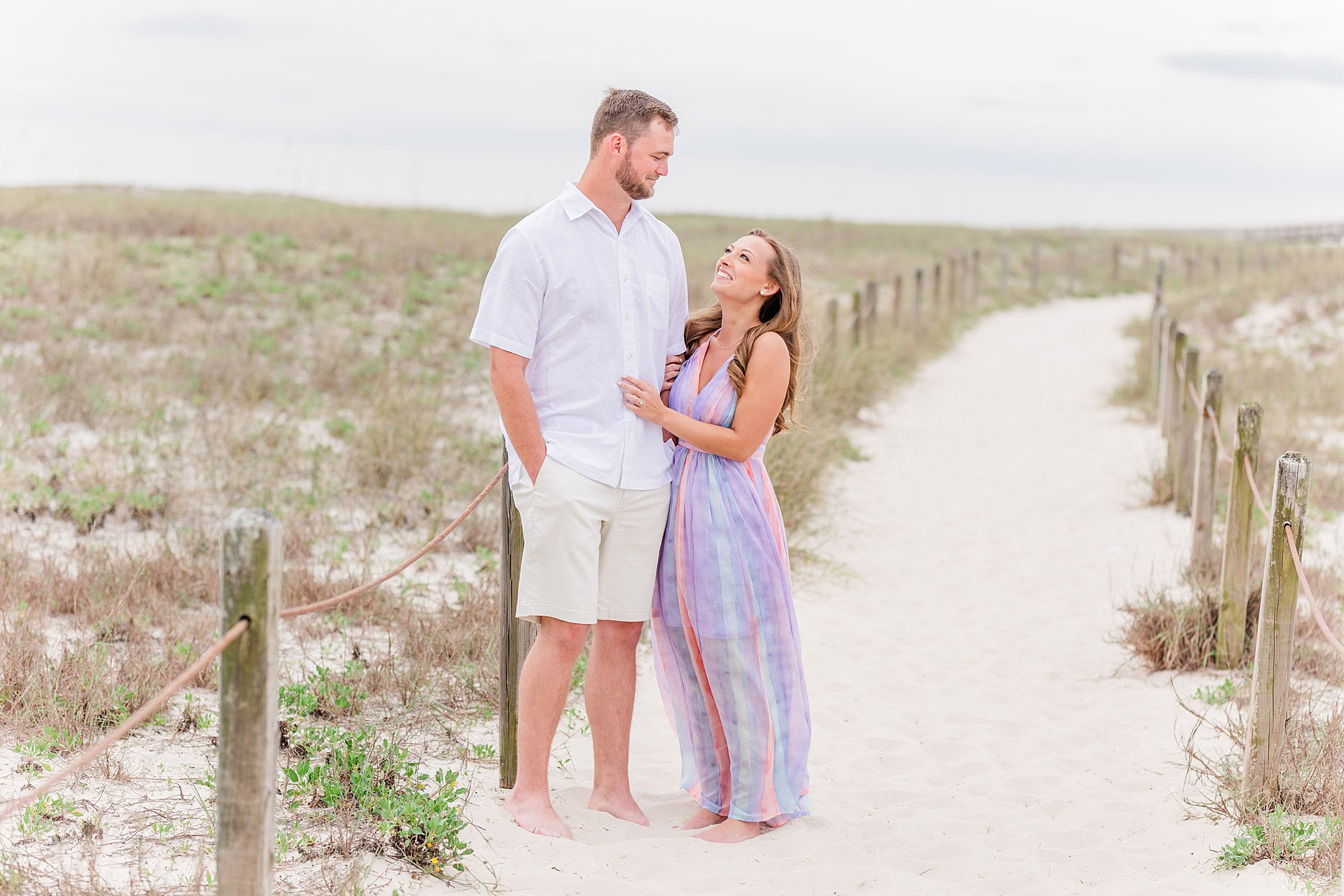 Bride and Groom starring at each other at their beach engagement session in Orange Beach, Alabama