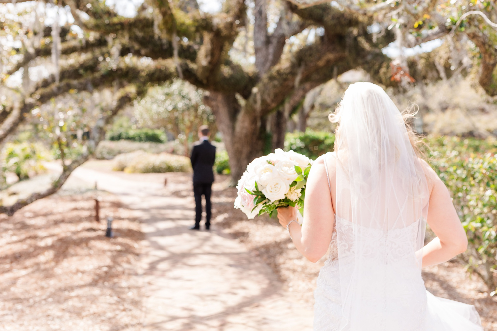 bride approaches groom for first look in Fairhope AL