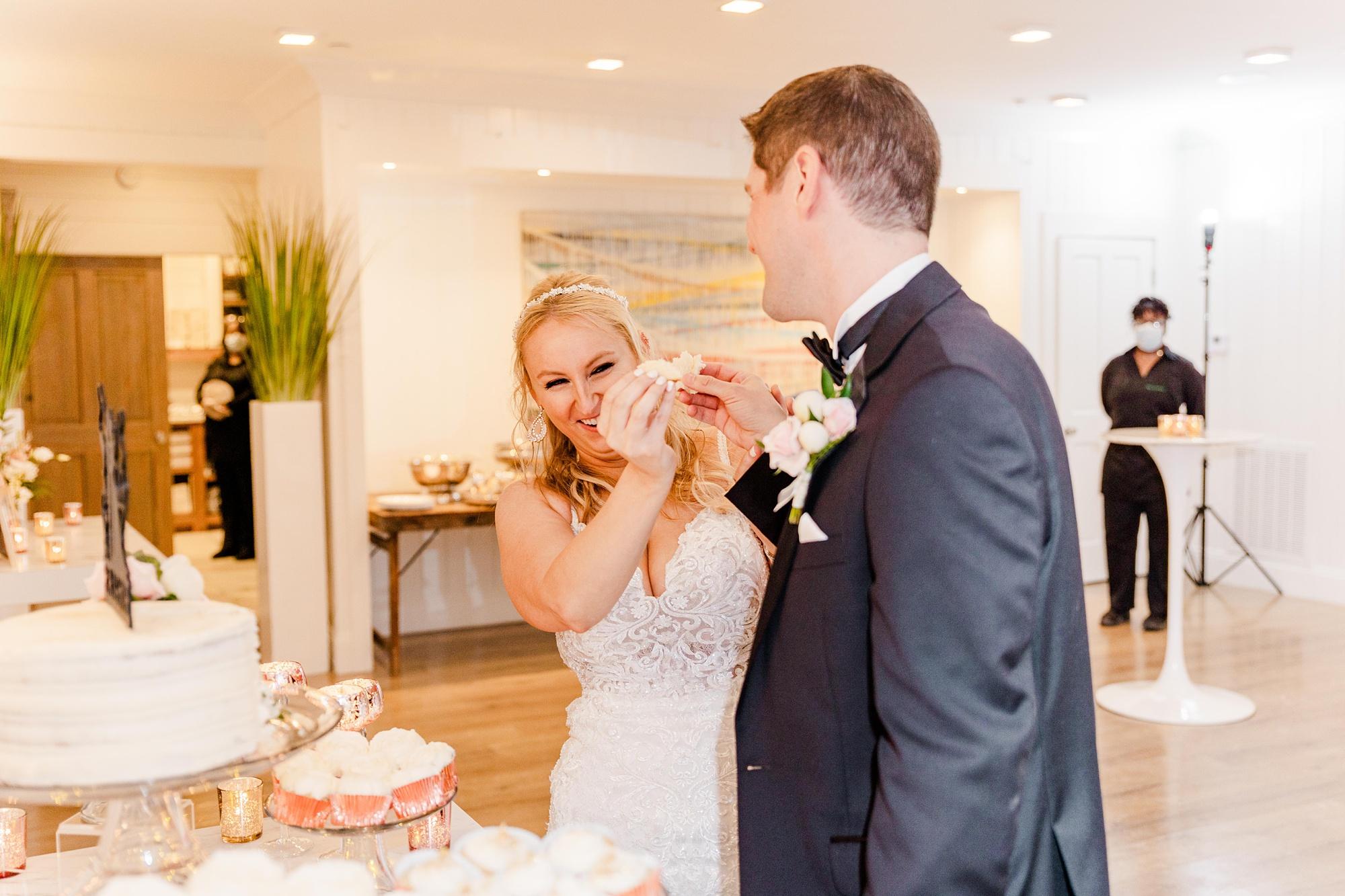 Fairhope AL wedding reception cake cutting for bride and groom