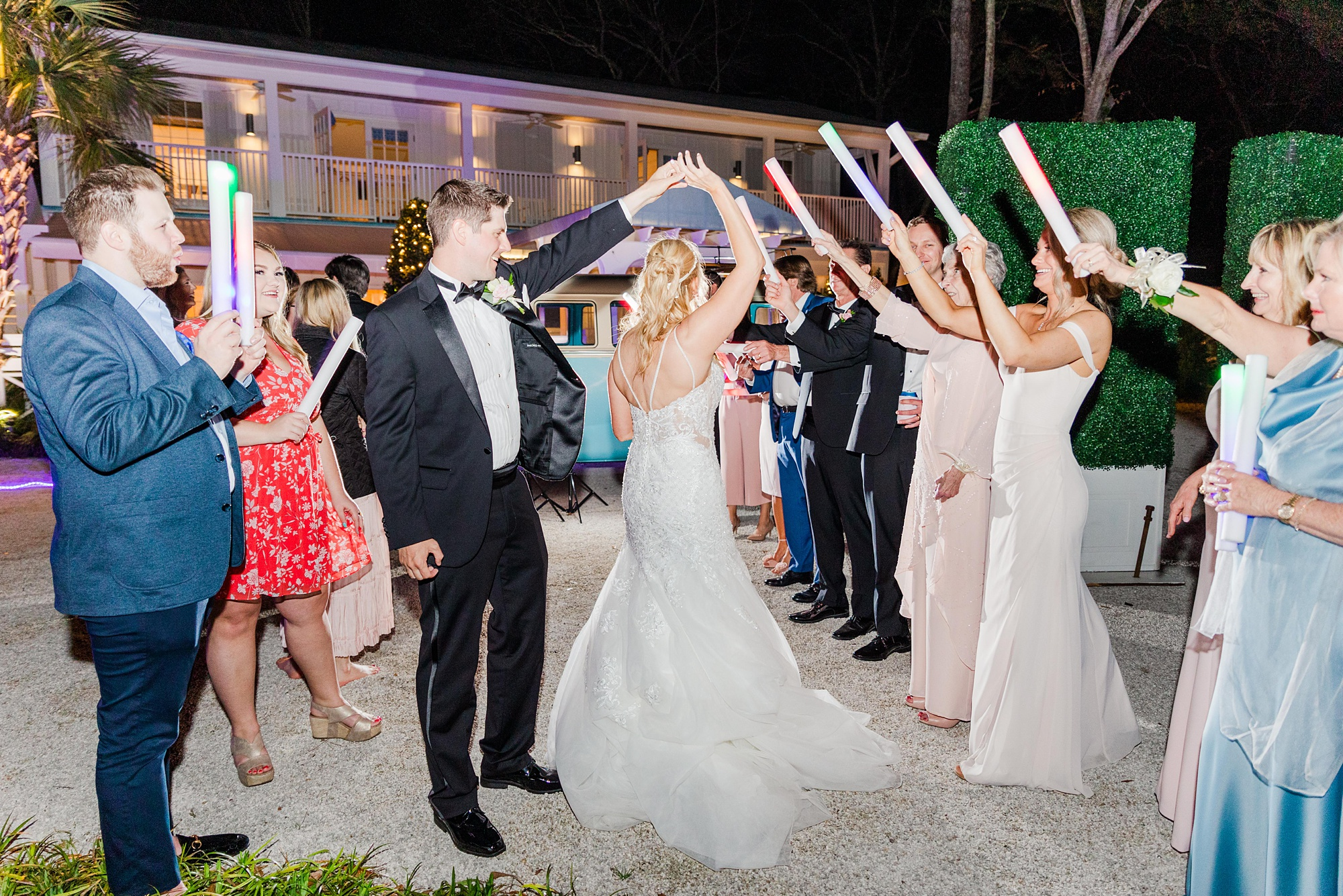 newlyweds dance under glow sticks during Little Point Clear wedding day exit