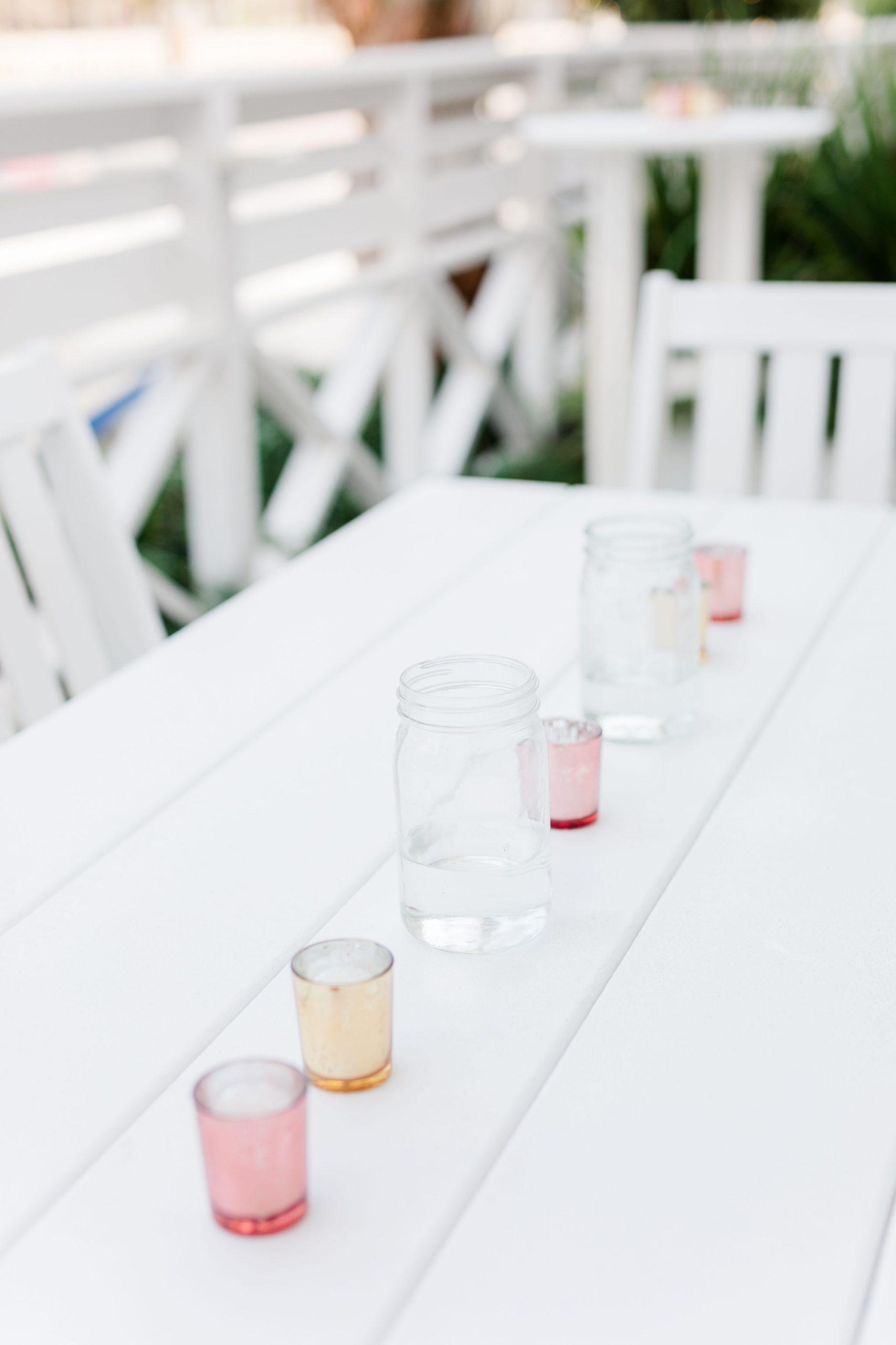 simple outdoor reception decor on white table in Fairhope AL