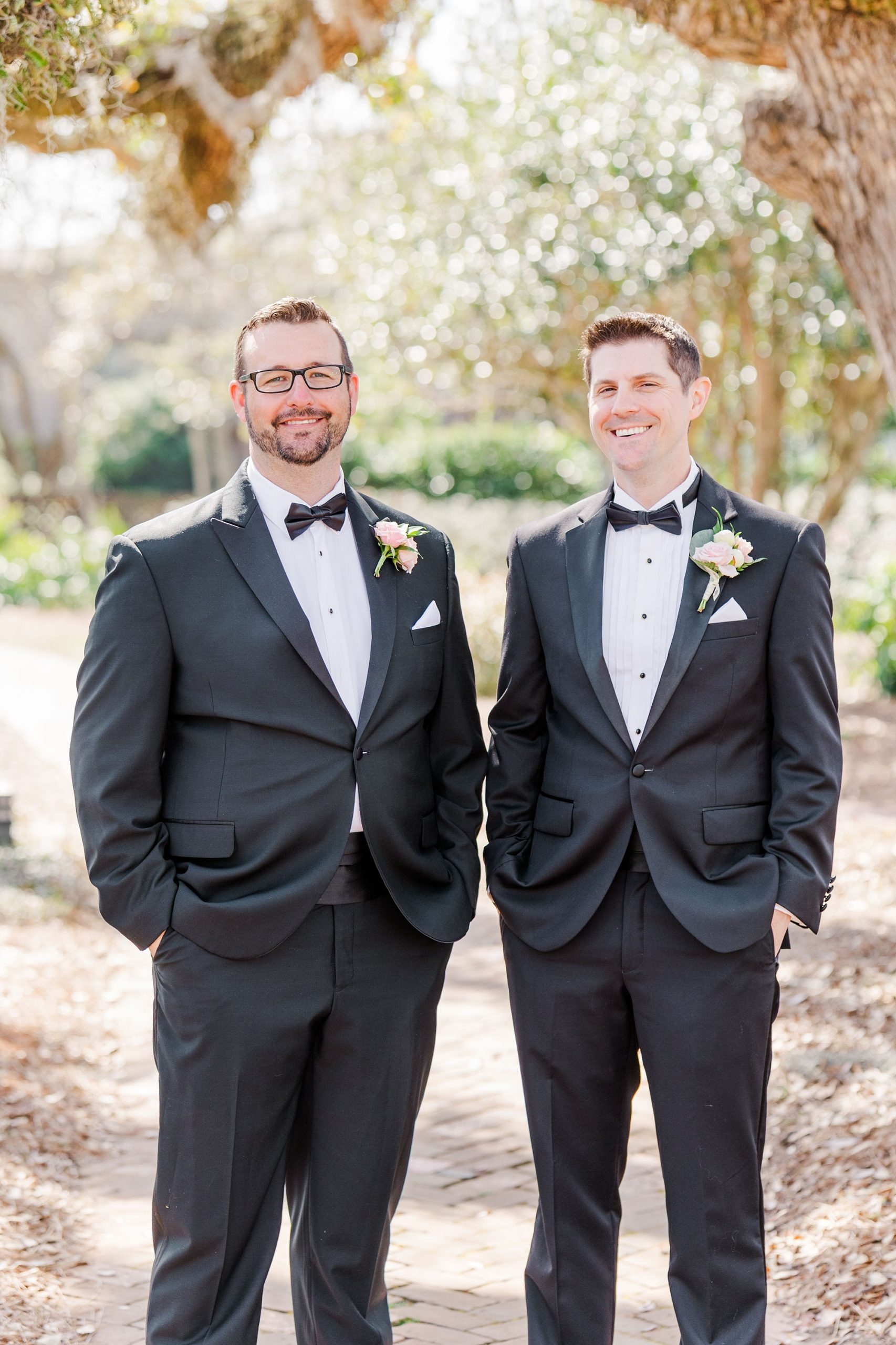 groom poses with groomsman during AL wedding day