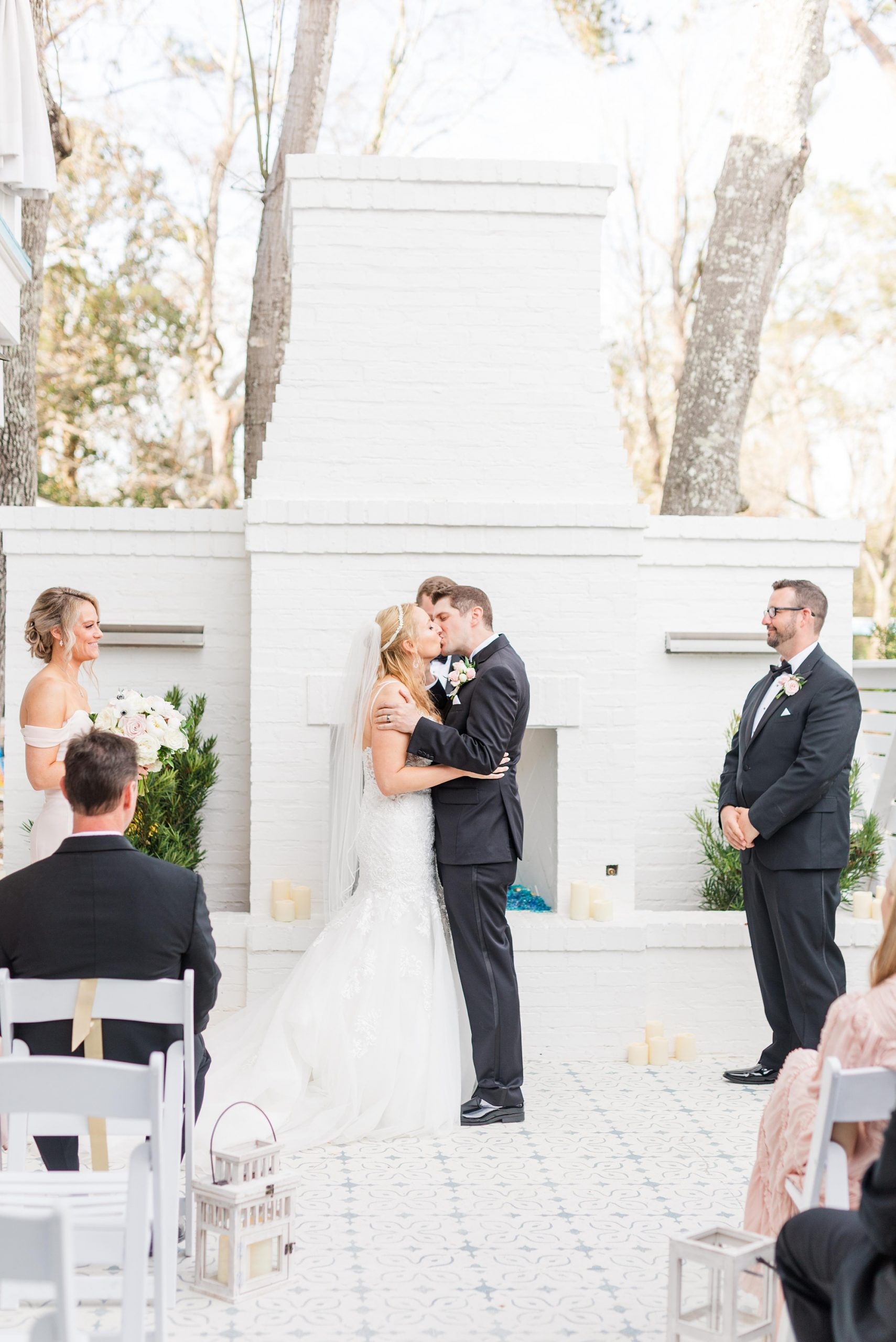 newlyweds kiss during Little Point Clear wedding ceremony