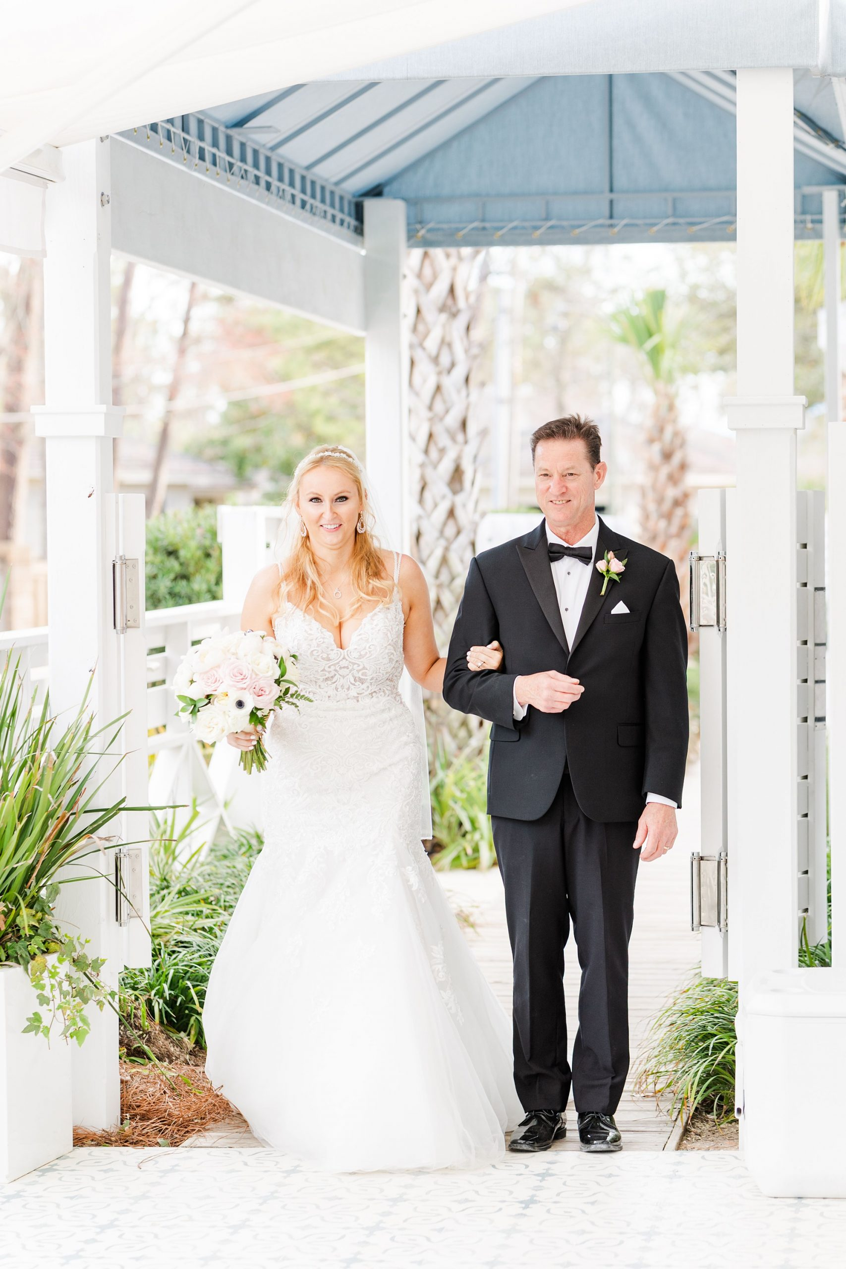 bride and father walk down aisle at Little Point Clear