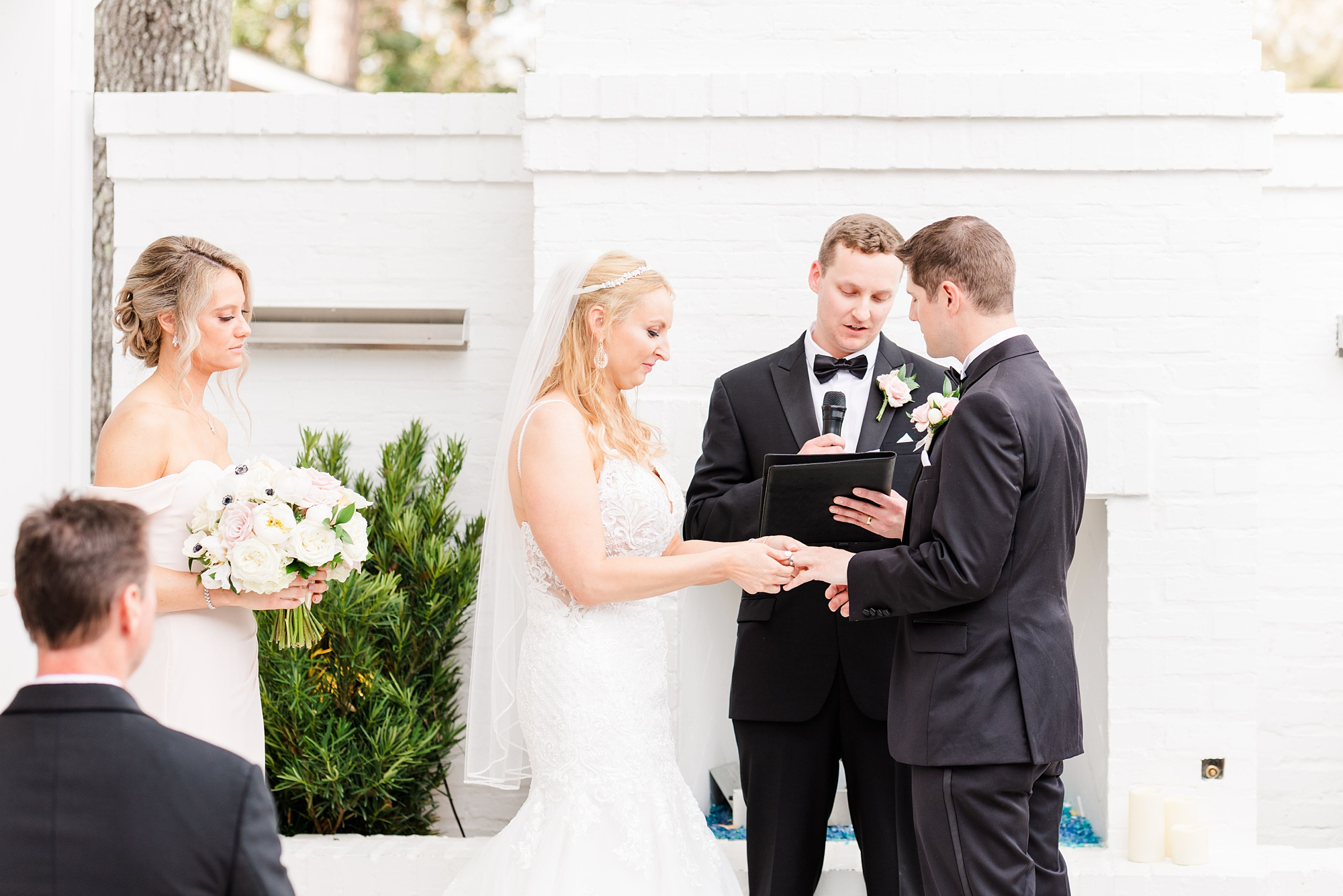 bride and groom exchange vows during Little Point Clear wedding ceremony