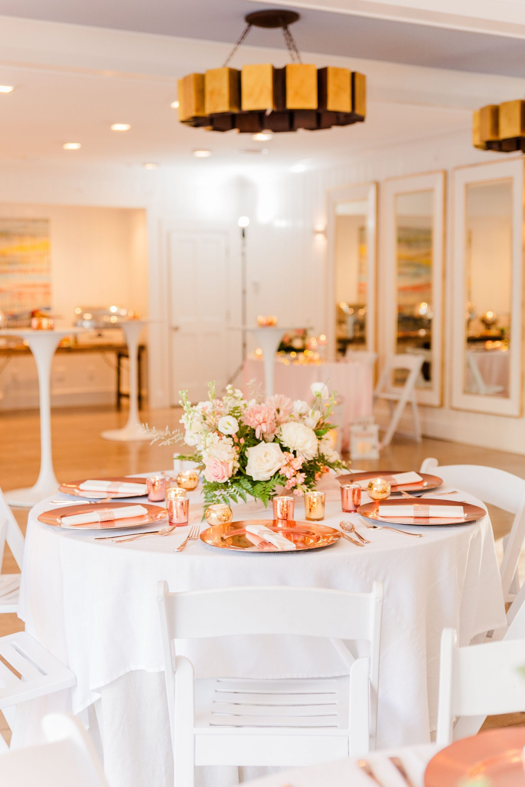 reception place settings with rose gold chargers