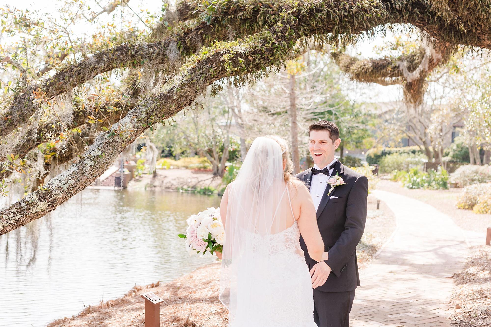 bride and groom have first look in Fairhope AL
