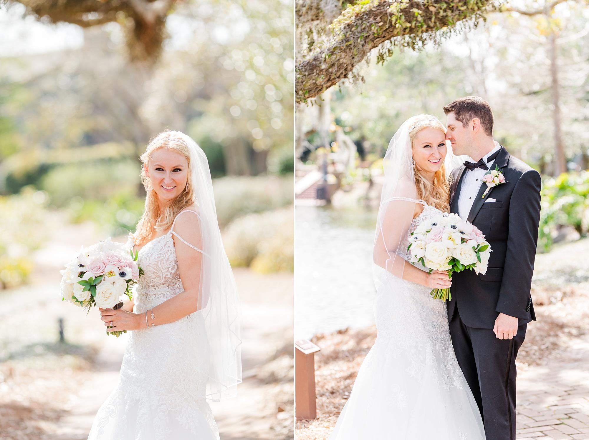 bride and groom pose under tree in Fairhope AL