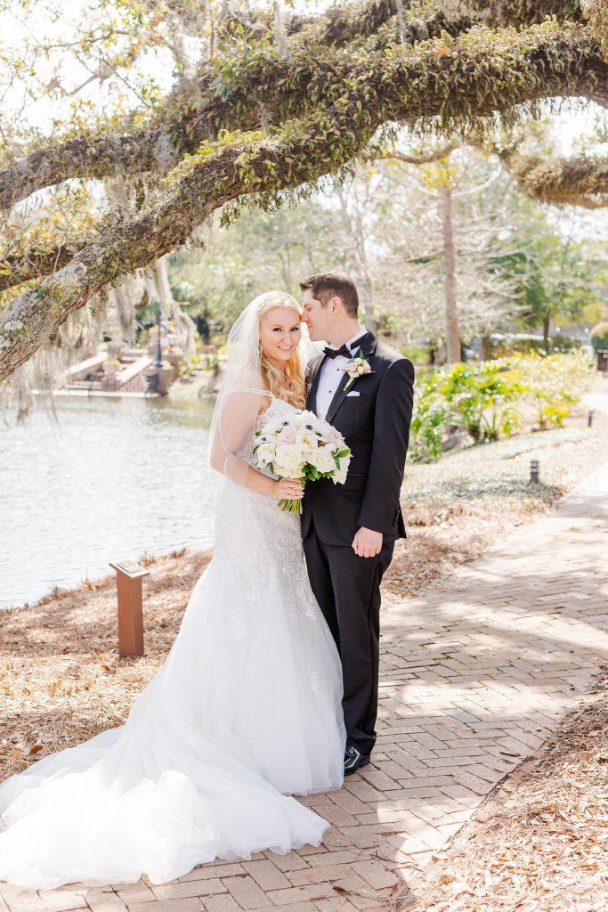 groom nuzzles bride's cheek in Alabama