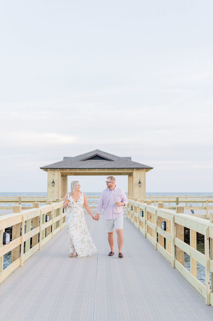 Bride and Groom walking down the pier at their Grand Hotel Engagement Session
