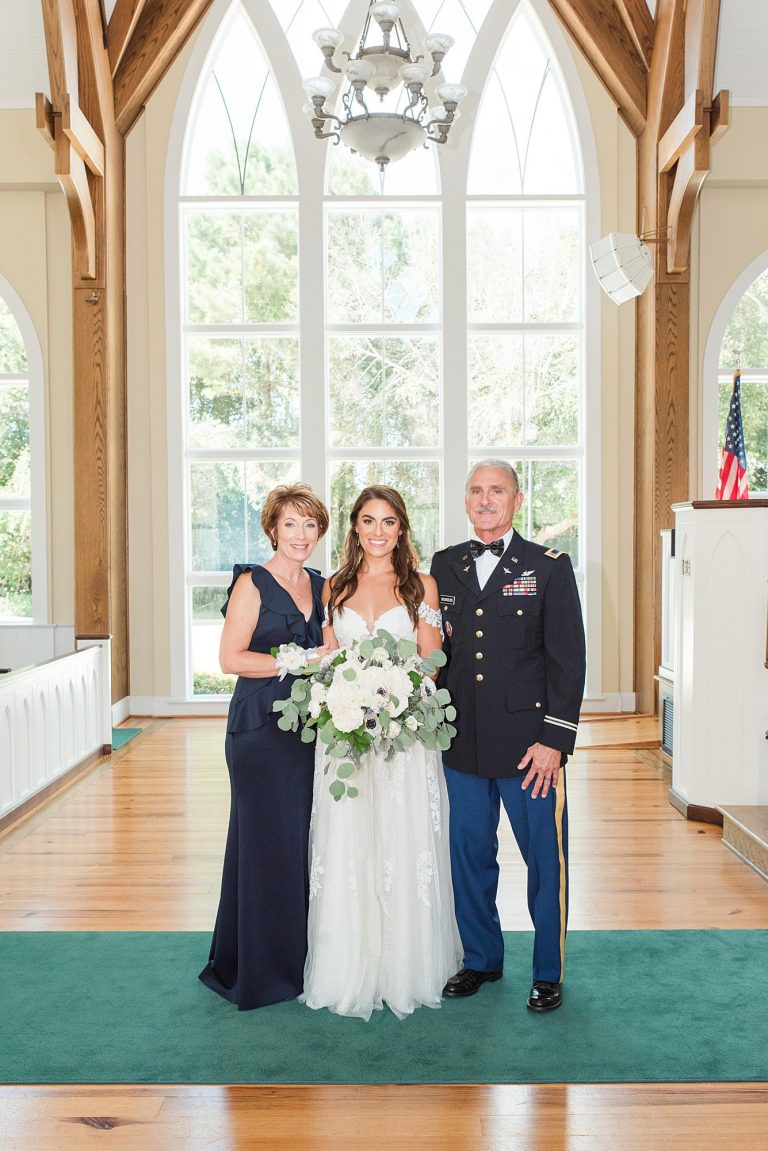 The Bride with her mother and father at her St. Francis at the Point Wedding