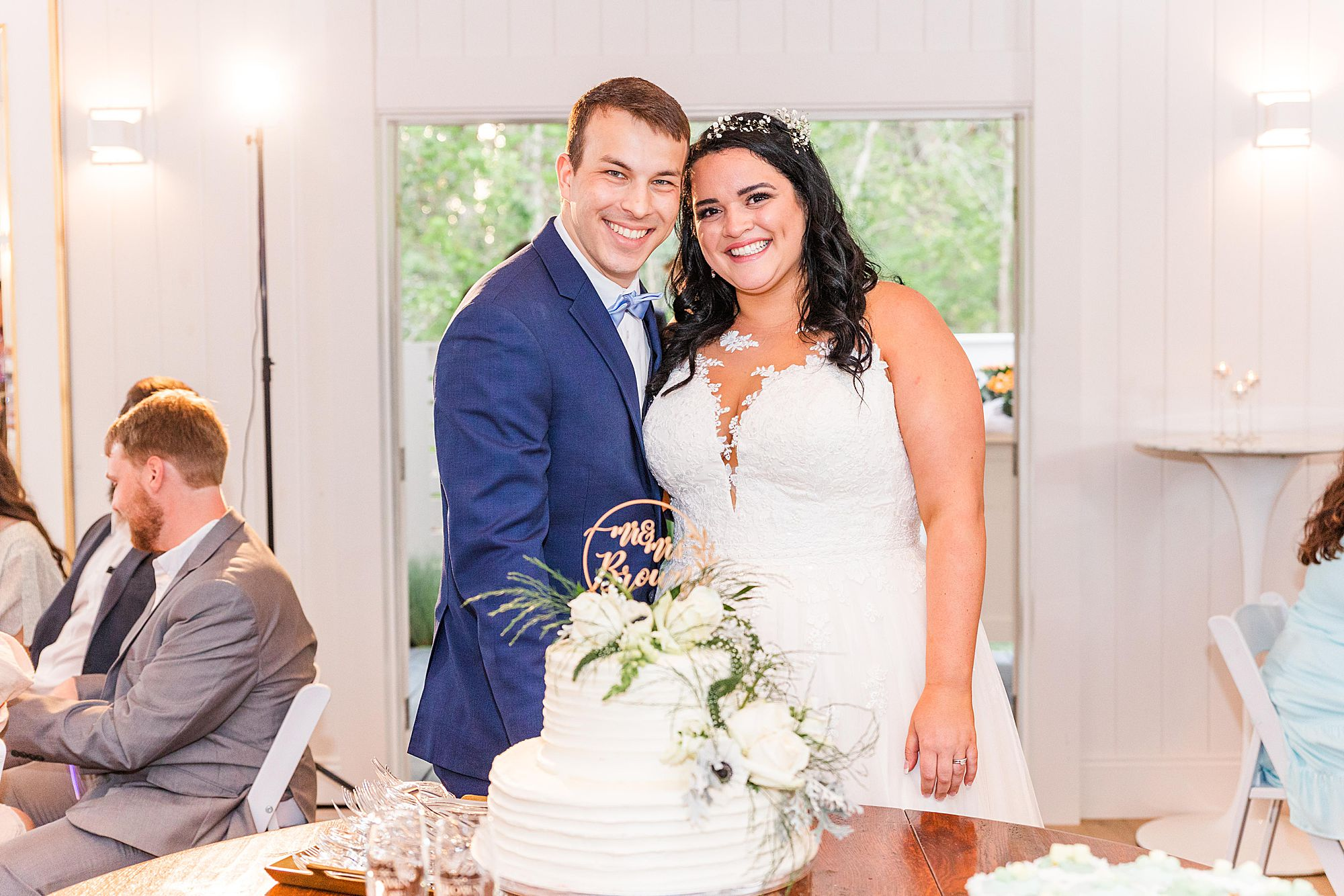cake cutting portrait of bride and groom