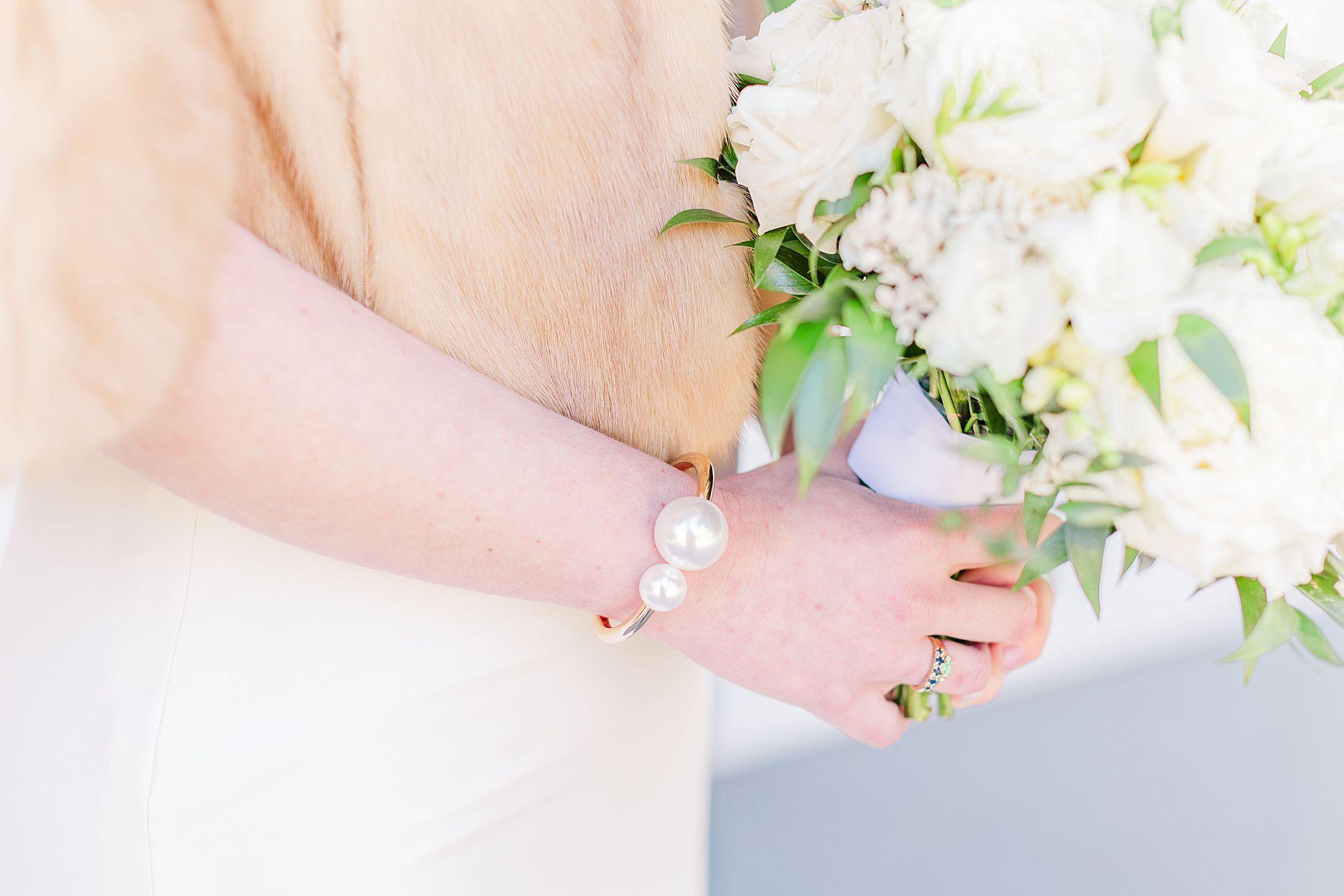bride wears pearl bracelet
