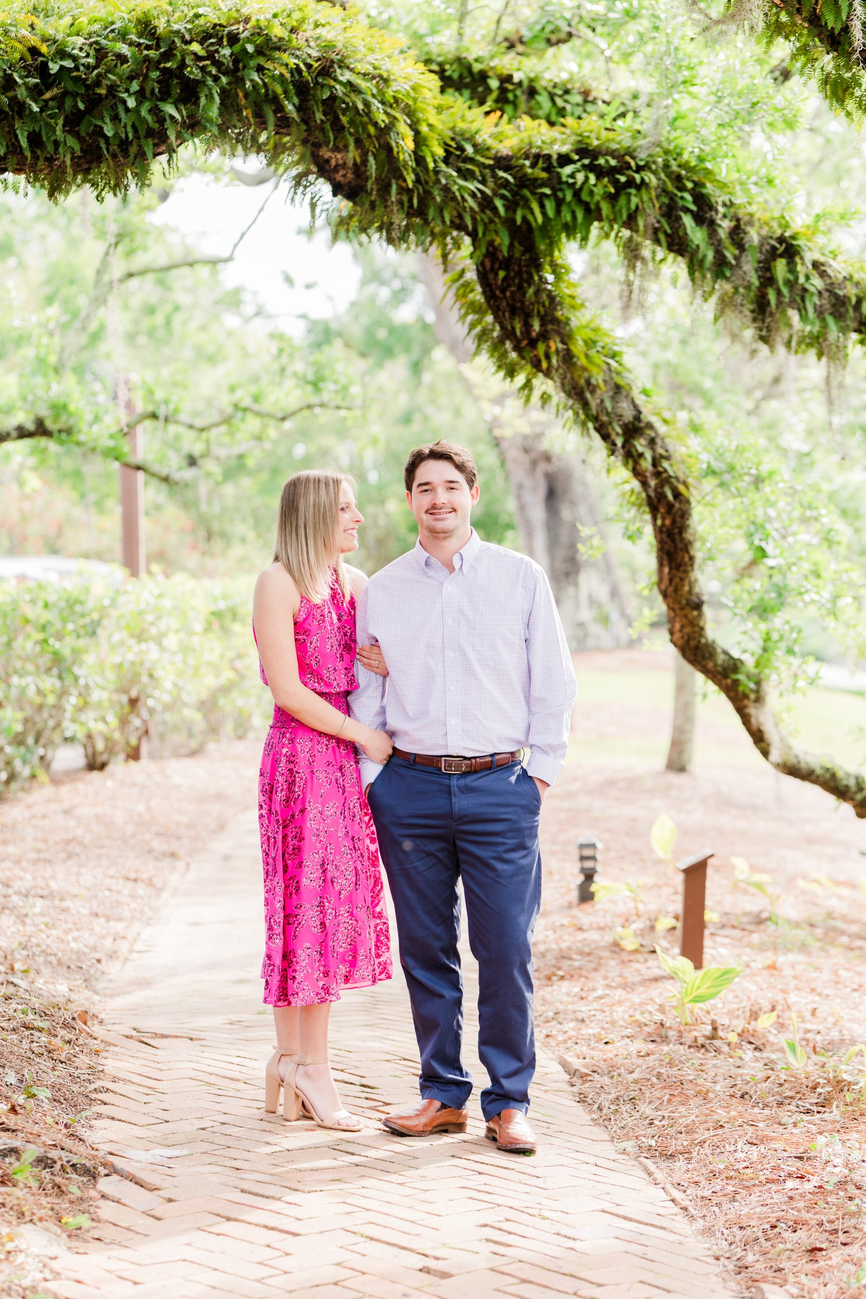 An Engaged Couple under a live oak at the Grand Hotel in Point Clear, Alabama photographed by Goodie and Smith Weddings