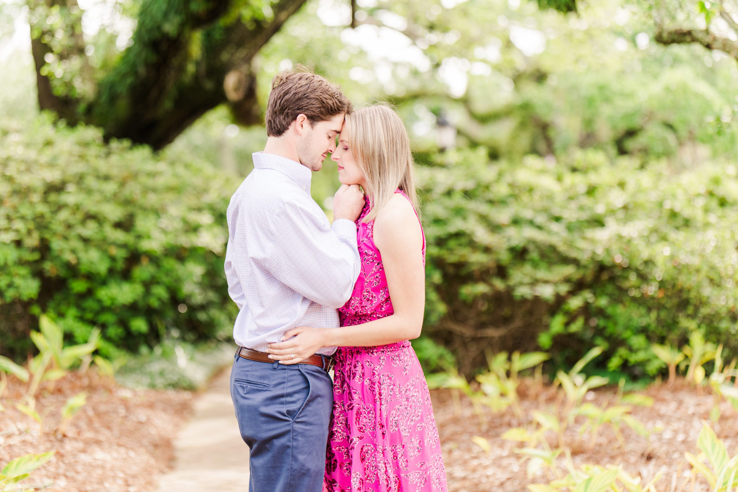 An Engaged Couple snuggling at the Grand Hotel in Point Clear, Alabama photographed by Goodie and Smith Weddings