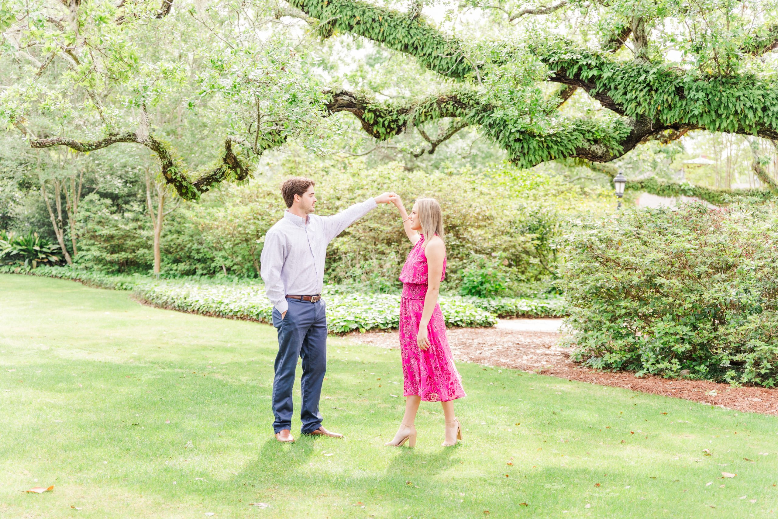 An Engaged Couple dancing under a live oak at the Grand Hotel in Point Clear, Alabama photographed by Goodie and Smith Weddings