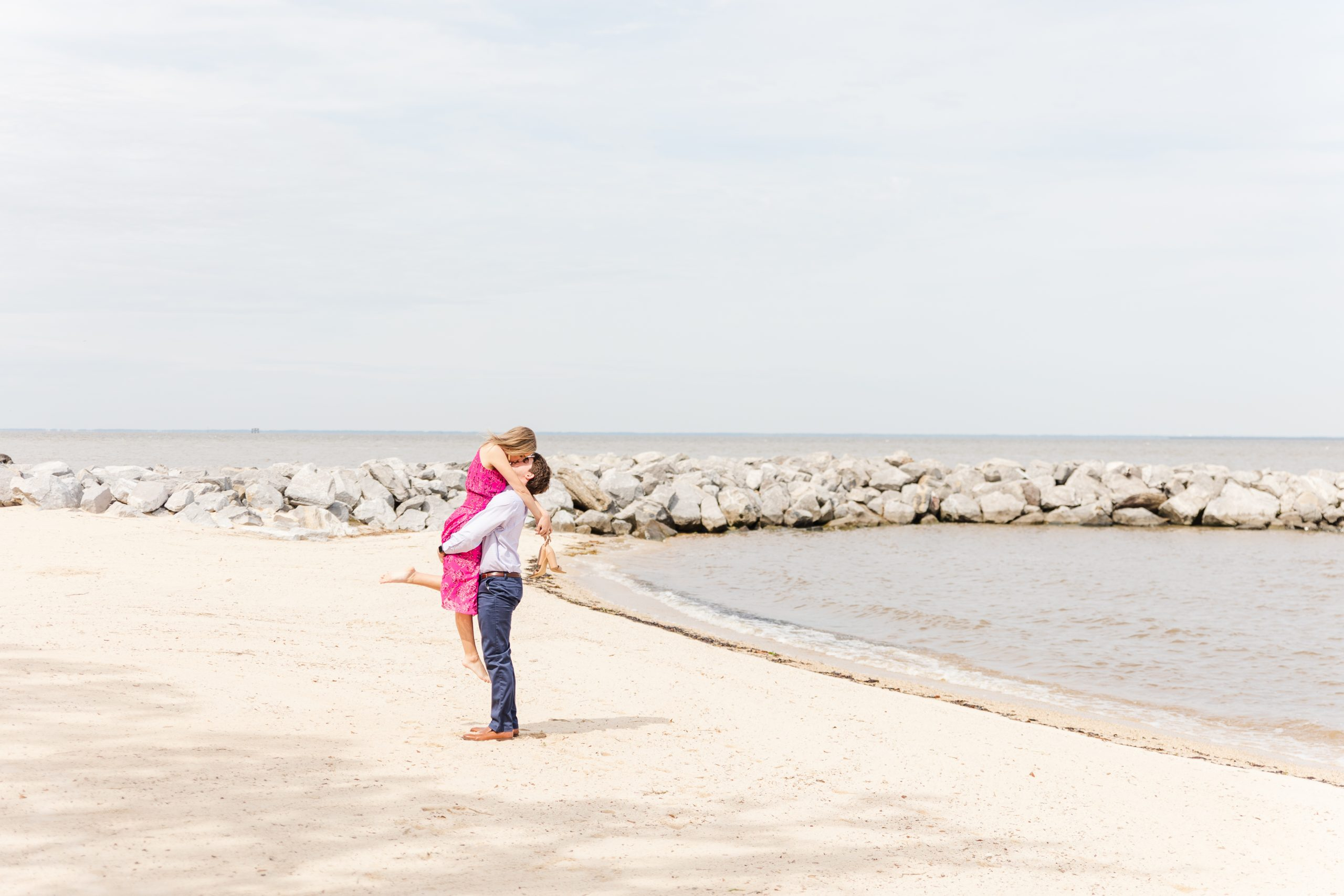 An Engaged Couple dancing at the beach at the Grand Hotel in Point Clear, Alabama photographed by Goodie and Smith Weddings
