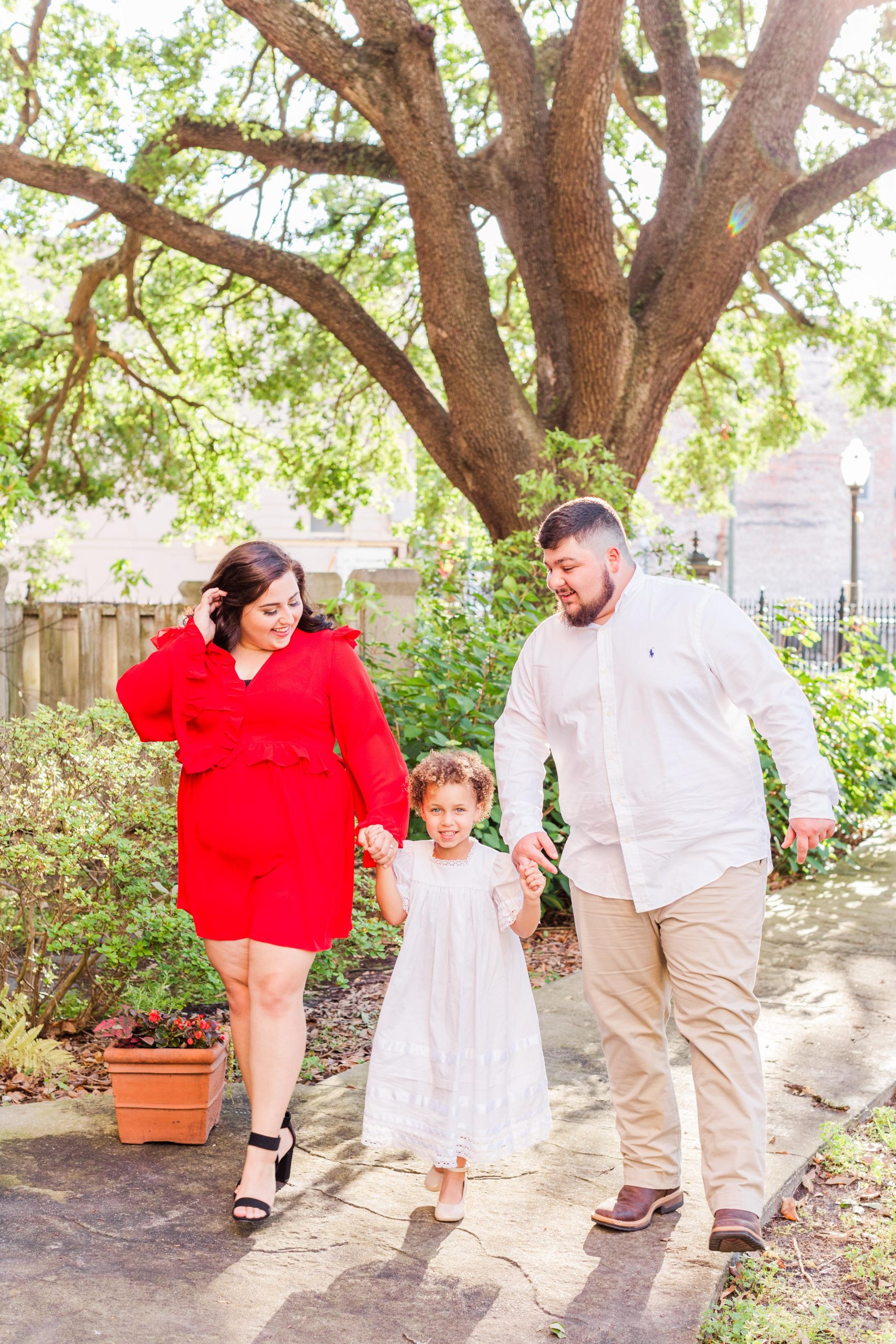 Bride and Groom with their daughter at their downtown Mobile Engagement Session