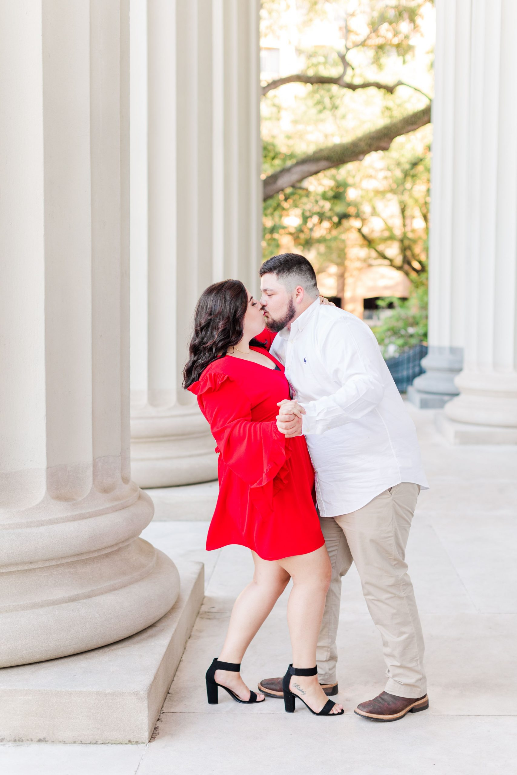 Couple kissing at their engagement session at the Cathedral