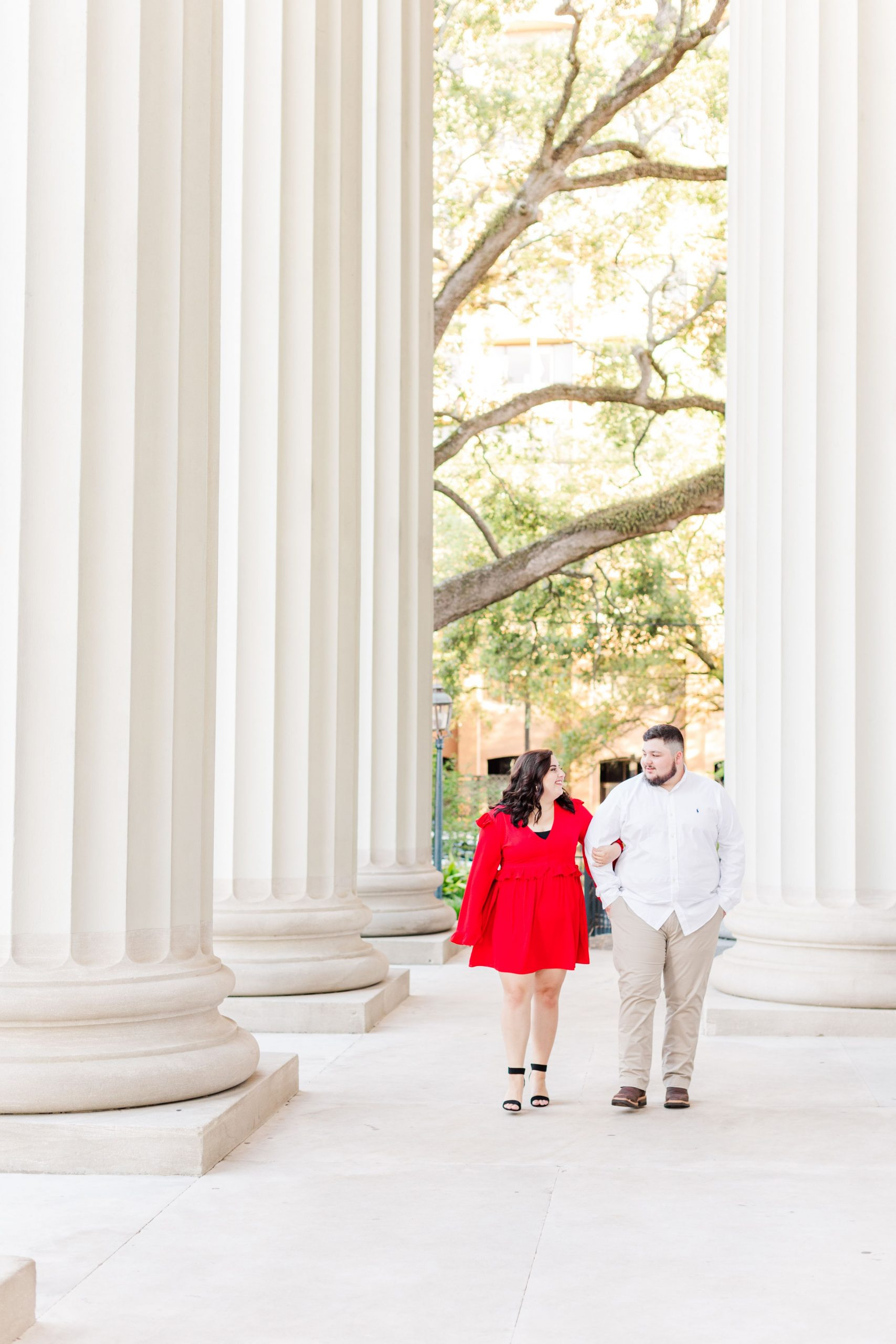 Couple walking at their engagement session at the Cathedral