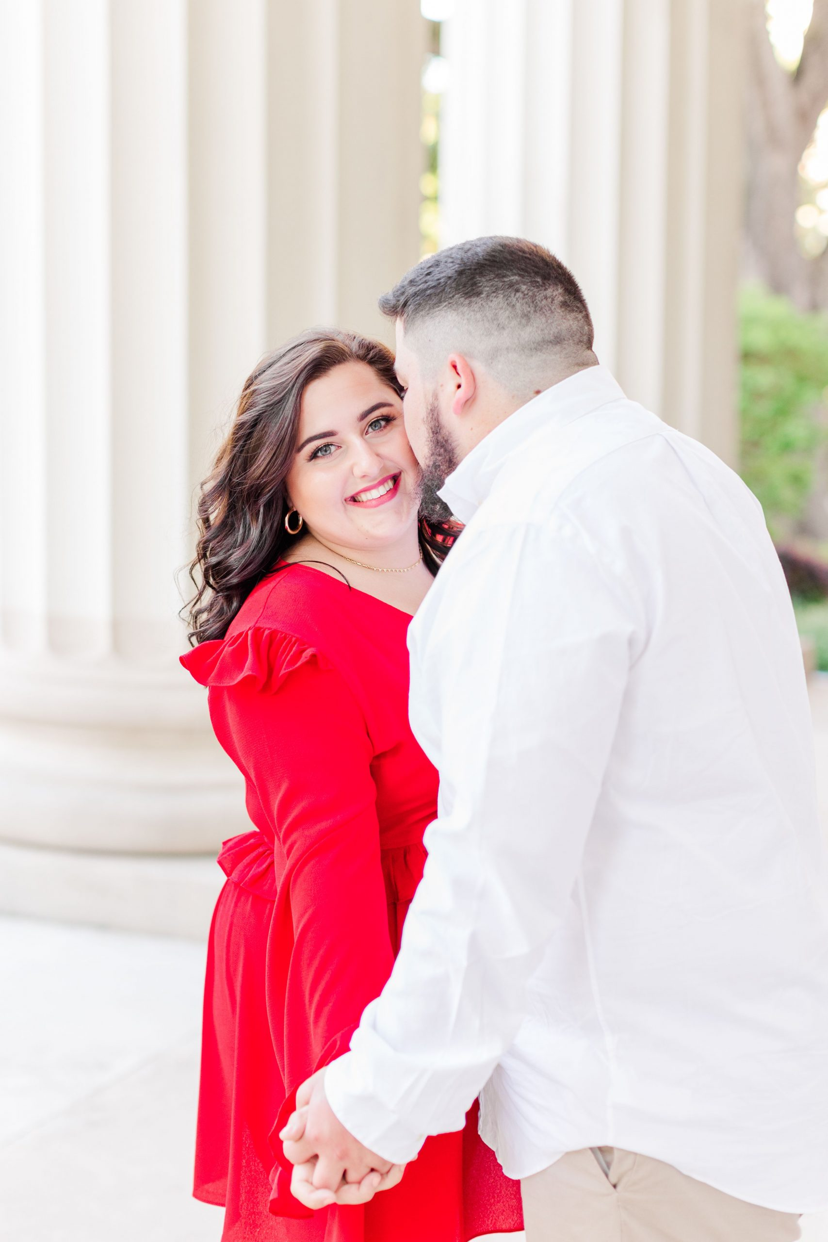 Groom nuzzling his bride at their engagement session at the Cathedral