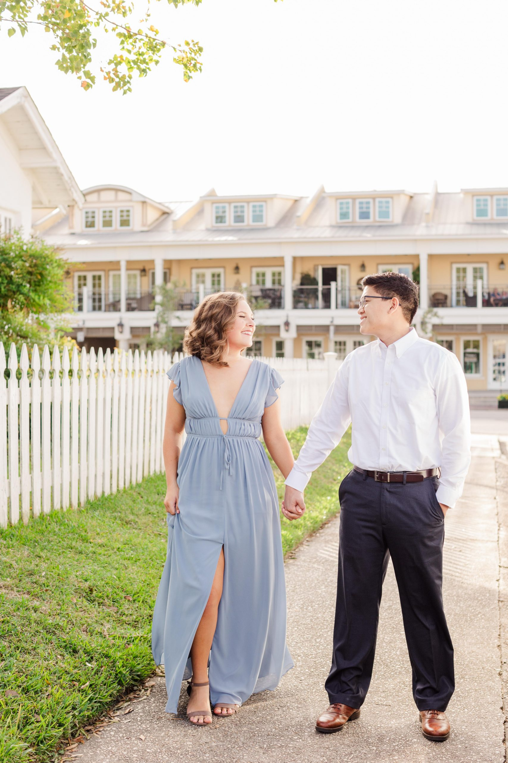 Couple walking at their Downtown Fairhope Engagement Session