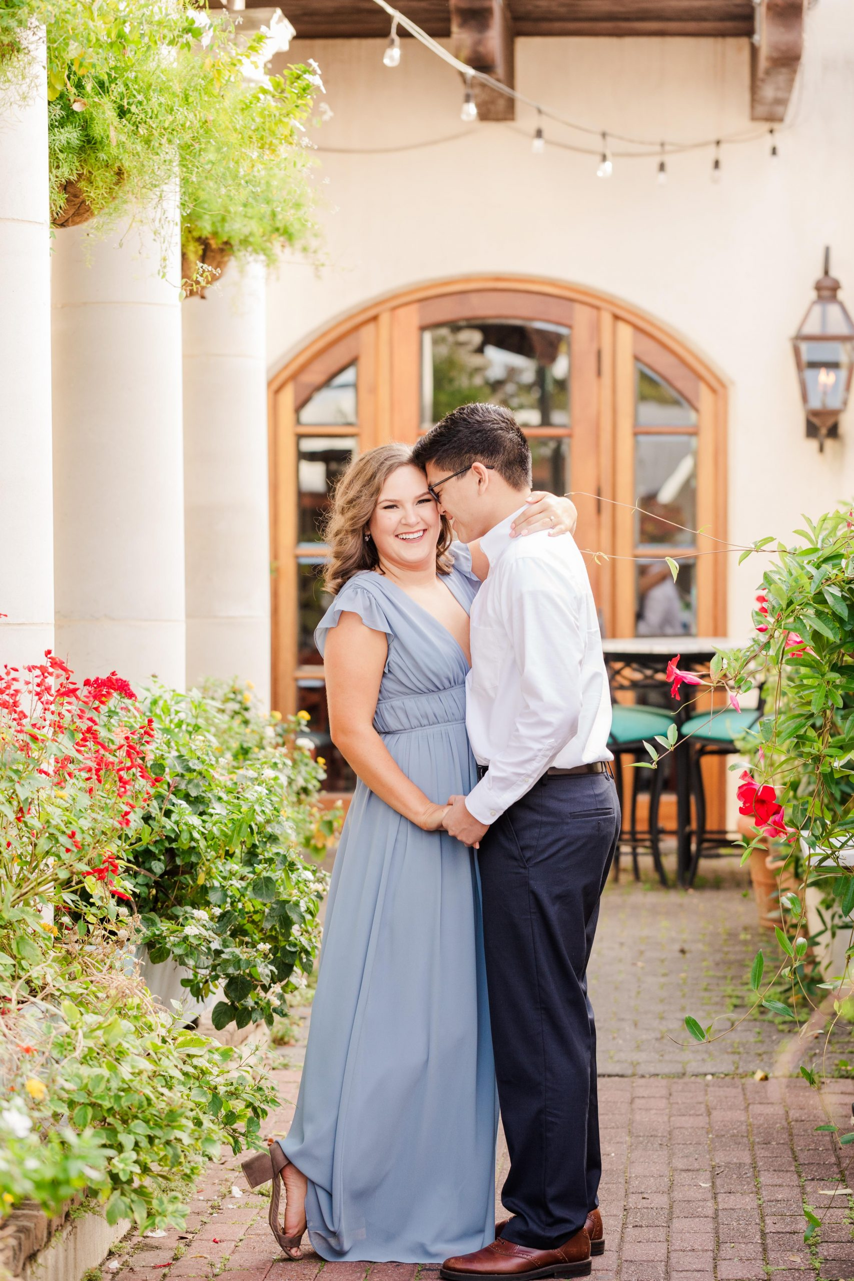 Couple snuggling at their Downtown Fairhope Engagement Session